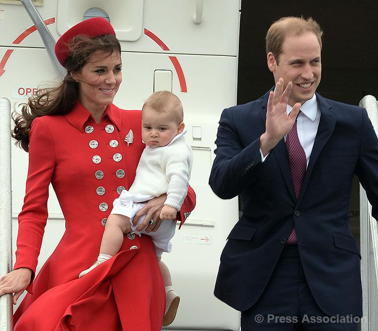 Wings of Whimsy: The Duke and Duchess of Cambridge arrive with Prince George on the first day of their official visit to Australia. Monday April 07, 2014. Photo credit: Anthony Devlin/PA Wire