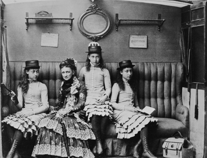 Wings of Whimsy: Queen Louise of Denmark with her grand-daughters, Princesses Victoria, Maud, and Louise of Wales, 1882