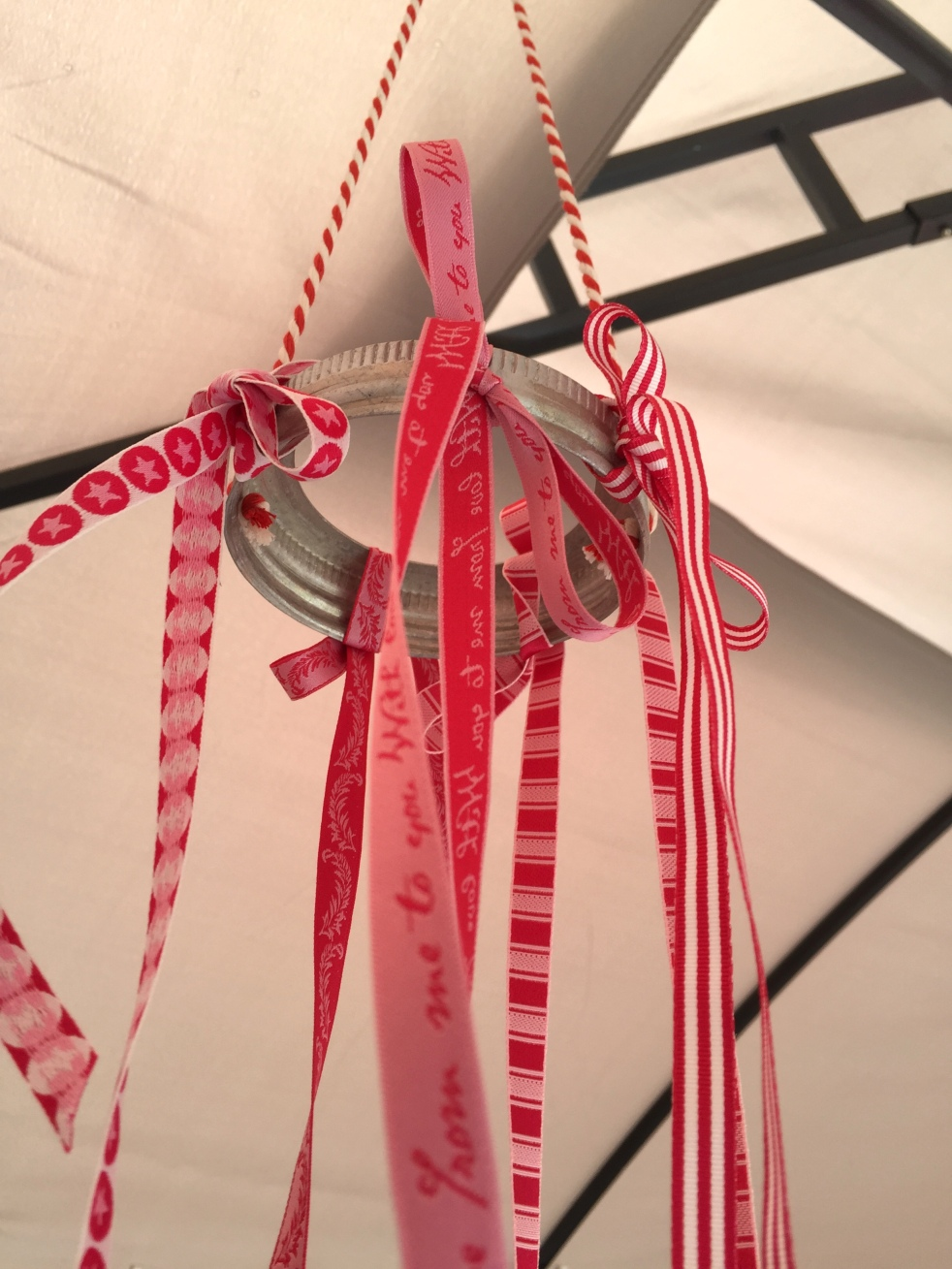 Wings of Whimsy: DIY Mason Jar Band & Ribbon Mobile #diy #ribbon #canningjarband #windsock #mobile